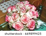 wedding pink bouquet of white... | Shutterstock . vector #669899425
