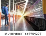 happy man traveler  a train... | Shutterstock . vector #669904279