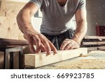 a young male carpenter builder... | Shutterstock . vector #669923785