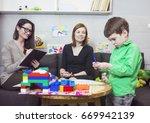 child psychologist at work  | Shutterstock . vector #669942139