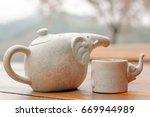 cute tea pot and tea cup ...   Shutterstock . vector #669944989