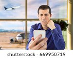 angry man looking to a phone at ... | Shutterstock . vector #669950719
