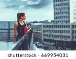young woman resting on the roof ... | Shutterstock . vector #669954031