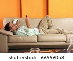 relaxed young man lying down on ... | Shutterstock . vector #66996058