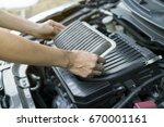 technician holding dirty air... | Shutterstock . vector #670001161