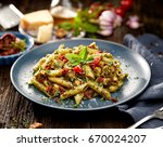 penne pasta with spinach  sun... | Shutterstock . vector #670024207
