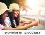 pair of cute female friends... | Shutterstock . vector #670025065