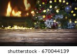beautiful decorated fireplace... | Shutterstock . vector #670044139