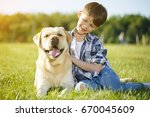 happy young boy sitting on the... | Shutterstock . vector #670045609