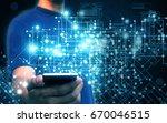 businessman holding virtual... | Shutterstock . vector #670046515