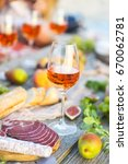 glass of rose wine and italian... | Shutterstock . vector #670062781