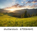 sunset in the mountain valley.... | Shutterstock . vector #670064641