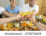 hands with white wine toasting... | Shutterstock . vector #670070659