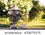 samovar and tea mug on natural... | Shutterstock . vector #670075375