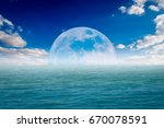 sea on a beautiful day with... | Shutterstock . vector #670078591