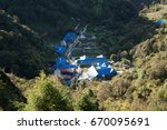 view on ghorepani from the hill ... | Shutterstock . vector #670095691