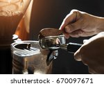 close up barista pressing... | Shutterstock . vector #670097671