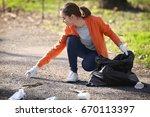 young beautiful volunteer... | Shutterstock . vector #670113397