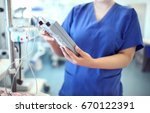 female doctor adjust electronic ... | Shutterstock . vector #670122391