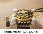 Small photo of Mechanical watch repair close up macro shot. Pocket watch machinery with cogwheels restoration craftworks hobby antique accuracy tools instruments parts mechanism inside vintage retro concept