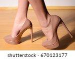 female feet in light brown high ... | Shutterstock . vector #670123177