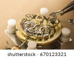 cropped close up of a repairman ... | Shutterstock . vector #670123321