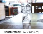 crystal glass with ice cubes on ... | Shutterstock . vector #670134874