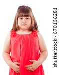 Small photo of ailing, sick small girl with stomach ache. Girl isolated on white background