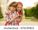 shot of a pretty little girl... | Shutterstock . vector #670139821