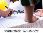 workers and manager in safety... | Shutterstock . vector #670150999