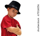 Boy looking cool with his hat on, slightly tilted to the side. - stock photo