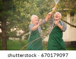 people having fun in garden.... | Shutterstock . vector #670179097