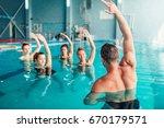 aqua aerobics in water sport... | Shutterstock . vector #670179571