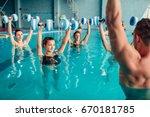 Small photo of Women aqua aerobics traninig with dumbbells