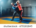 woman fights with man on self... | Shutterstock . vector #670181845