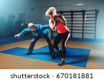 woman in actoin on self defense ... | Shutterstock . vector #670181881