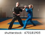 male and female wushu fighters... | Shutterstock . vector #670181905