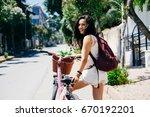 happy smiling girl in tropical...   Shutterstock . vector #670192201
