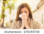 woman with allergy symptoms... | Shutterstock . vector #670193734