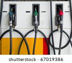 front of three gas pump nozzles ...   Shutterstock . vector #67019386