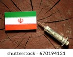 iranian flag on a stump with... | Shutterstock . vector #670194121