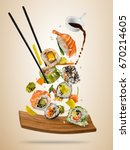flying sushi pieces served on... | Shutterstock . vector #670214605