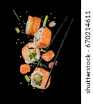 sushi pieces placed between... | Shutterstock . vector #670214611