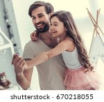 cute little daughter and her... | Shutterstock . vector #670218055