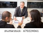 people at work in their office | Shutterstock . vector #670224061