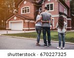 back view of happy family is... | Shutterstock . vector #670227325