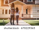 back view of happy family is... | Shutterstock . vector #670229365