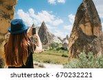 a tourist girl makes a photo on ...   Shutterstock . vector #670232221