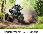 Atv Rider Creates A Large Clou...