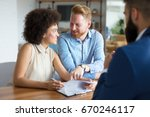 couple buying a house. | Shutterstock . vector #670246117